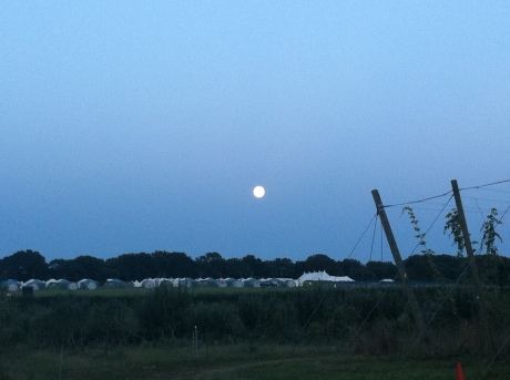 A full moon over the glamping field