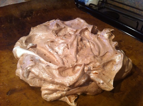 Glossy chocolate pavlova on its way to the oven