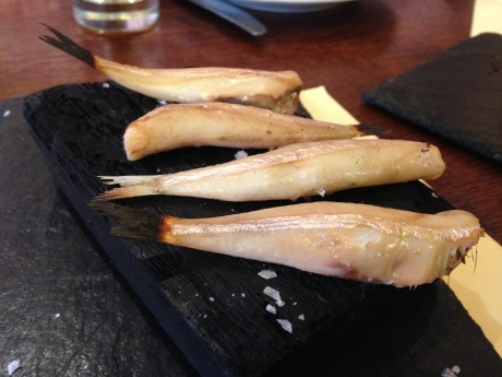 Anchovies served on a hot coal with a waft of sherry