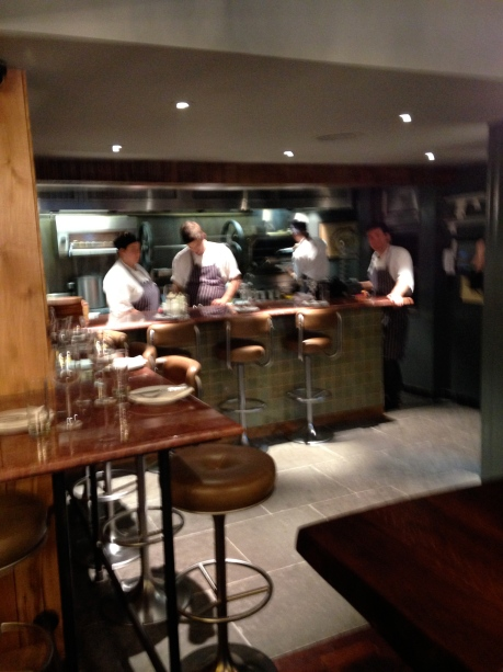 A blurry pic of the kitchen and Mr Tish at the helm