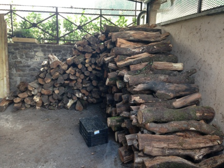 Oak logs - the cooking fuel piled up outside
