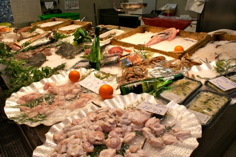 A fish counter at San Sebastian's La Bretxa market show how much more can be added to displays with wooden boxes, oranges and bottles of wine to inspire