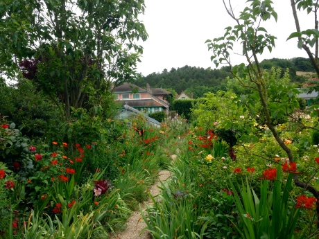 Monet's House peeking through the immense gardens